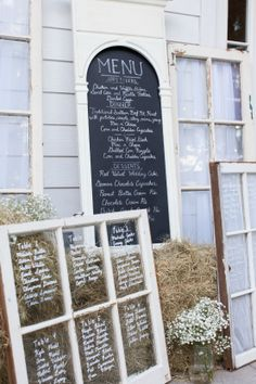 Chalkboard dinner menu and table seating chart using old windows from our rustic themed fall wedding.  Copyright - Jerdan Photography