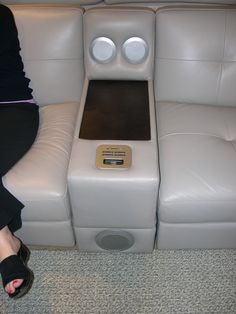 HTL Leather Sofa - Note the built-in media console. USB, SD Card reader, iPod dock, volume control, speakers and wood media rest.