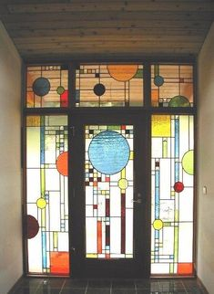 Geometric Front Door_Everyone who enters this home is greeted by an intricate stained-glass pattern inspired by Frank Lloyd Wright-designed windows. The fresh red and blue hues fantastically complement the rich wood of this entryway. Stained Glass Door, Stained Glass Designs, Stained Glass Patterns, Leaded Glass, Mosaic Glass, Beveled Glass, Mosaic Mirrors, Mosaic Wall, Mosaic Patterns