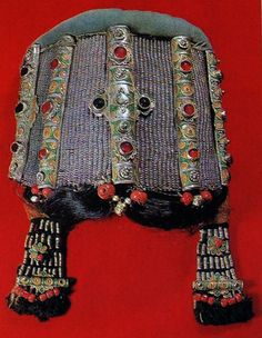 "Morocco | ""Mahdur"" worn by young Jewish girls and woman.  Made of silver thread and ornamented with enamel, filigree, semi-precious stones and colour glass.  It is interwoven at the base with horsehair, which is drawn in brands across the forehead and falls over the ears 