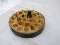 This rustic essential oil holder is made from beetle killed Aspen tree found while out cutting wood in the National Forest. The tree had shed its bark long ago.  It is about eight and a half inches in diameter and one and a half inches tall. This pictured piece was stained with natural Danish oil to bring out the unusual grain and finished with multiple coats of matte lacquer. It was drilled in three different depths to make it easier to find a particular bottle. This one is made to…