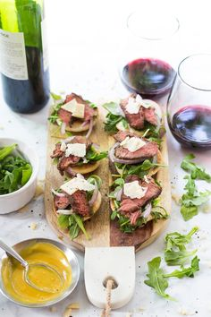 These Steak and Arugula Salad Bites with Parmesan are the ultimate weekend indulgence, and come together with just a few simple ingredients along with a delicious honey dijon sauce.