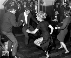 Black & white photograph of 60s dance party. Let's do the twist!