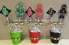 Planning a Ninja or Lego Ninjago birthday party? This listing is for one center piece set. You will receive 4 center piece sticks as shown above PLUS a color matching re-usable metal pail and paper shred.  These look great as décor items on your guests tables, the dessert table, in the entrance hall welcoming guests to the party and can even be used as photo props!!  Matching party décor available too such as banners, favor boxes or bags, cupcake toppers, favor tags and door signs…