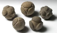 Strange Prehistoric Carved Stone Balls: Hundreds of small, carved stone balls have been discovered in Scotland. These 5 are on display at Ashmolean Museum and their purpose is unknown! Theories run the gamut from weapons to models of atoms. Personally, I think they might be gaming pieces, like dice! Or, possibly used for divination or fortune telling.