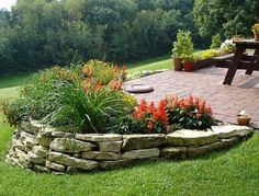 flower bed,stone wall design...charming yard landscaping idea use at stop sign in front yard