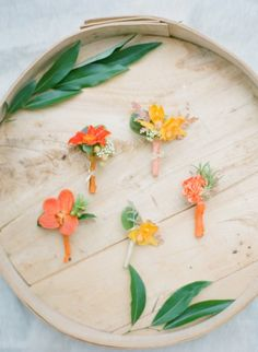 Pretty orange boutonnieres by Sugar Magnolias