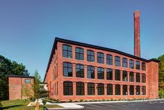 Image 7 of 14 from gallery of Yarn Works / The Architectural Team. Photograph by Andy Ryan Rive Nord, Team Photos, Architecture, It Works, Brick, Multi Story Building, Lofts, Gallery, Image