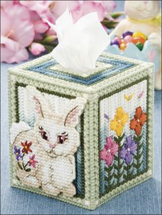 Flower Bunny Plastic Canvas Pattern Download from e-PatternsCentral.com -- Variegated yarn and just the right embroidery touches make our finely detailed tissue cover surprisingly easy to stitch, with outstanding results.