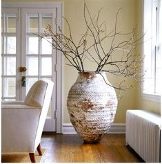 Large pots with whimsical sticks.