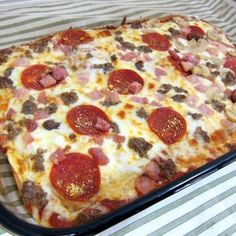 Doughless Pizza crust - NOT made with cauliflower!  Made this tonight with sauce, browned sausage, sautéed mushrooms, onion, garlic, bell peppers & a mixture of mozzarella & Parmesan - YUMMY! Carbless way to satisfy my pizza craving.