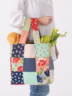 Turn a package of precut squares into a tote that's perfect for your trips to the market! Easy to assemble and a quick project for any afternoon! Bag size, 13 x 13 x 4 Previously published in Quilter's World . Bag Patterns To Sew, Tote Pattern, Sewing Patterns, Quilt Pattern, Easy Tote Bag Pattern Free, Canvas Patterns, Quilted Tote Bags, Patchwork Bags, Sew Tote Bags