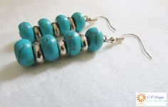 These are the sea blue turquoise stoned earrings that go along with the silver and turquoise snake chain bracelet.