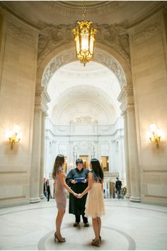 Us at our City Hall wedding! - Photo by Emily Takes Photos