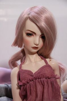 Dolls kind of freak me out...but yet, I'd love to have hair this color...as long as I had a mauve dress to match, too