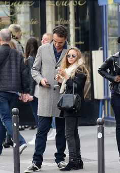 Mary-Kate Olsen layers up for fall in Paris with Olivier Sarkozy. #style #fashion #olsentwins
