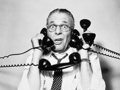 1950s 1960s Portrait Of Frazzled Businessman Trying To Answer Four Black Telephones Phones At Once Photographic Print by DeBrocke