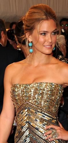 bar rafaeli's turquoise drop earrings look amazing with her gold and jewel-encrusted gown