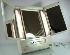 Lighted makeup mirror with different time of the day settings. Had this.