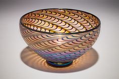 The iridescence on the outside and optic design capture the eye when light flows through this beautiful bowl. Available at artfulhome.com