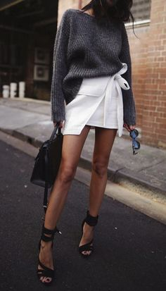Grey sweater, white mini skirt, black lace up heels and black bag