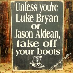 "Unless You're Luke Bryan or Jason Aldean, Take Off Your Boots  •.,¸¸,:•:*♥*:•:,¸¸,:•:*♥*•.,¸¸,:•:*♥*:•:,¸¸,:••.,¸¸,:•:*♥*:•:,¸¸,:•:*♥*•.,¸¸,:•:*♥*:•:,¸¸,:•    Hand painted One Of A Kind Sign on a Pine Board    As pictured: Black Distressed with antique white lettering.  Measures 9"" x 13""  Key hol..."