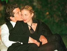 John F. Kennedy, Jr. editor of George magazine, gives his wife Carolyn a kiss on the cheek during the annual White House Correspondents dinner May 1, 1999 in Washington, D.C. July 16, 2000 marks the one year anniversary of the plane crash which killed Kennedy, his wife and sister-in-law.