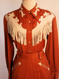 Someday I hope to find a cool vintage western outfit like this.