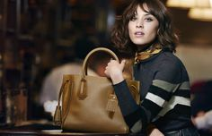 Alexa Chung poses with Longchamp's Pénélope Fantaisie bag for the label's fall-winter 2016 campaign.