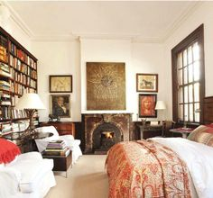 Would be heaven to lay in bed on a lazy morning, a book in your hand and a wall of books in front of you :)