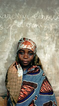 Africa | Tchadé in front of the blackboard.  Ketou, Benin | ©David Paul Carr #portraits #tailoredforeducation