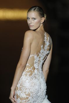 "The Top 5 Wedding Dress Trends To know in 2014 - shown here ""Sheer panels"""
