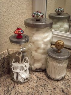 Pinterest inspired project i just did. Save glass food jars, spray paint lids, add decorative knobs! Perfect for cotton ball/q-tip storage, or keep in your kitchen with pasta, rice, etc...