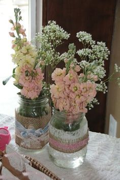 Decorated mason jars at a cowgirl chic baby shower birthday party! See more party ideas at http://CatchMyParty.com!