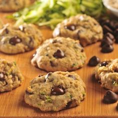 Zucchini-Oat Dark Chocolate Chip Cookies    1 1/2 cups all-purpose flour  1 teaspoon ground cinnamon  1/2 teaspoon baking soda  1/2 cup (1 stick) butter, softened  3/4 cup granulated sugar  1 large egg  3/4 teaspoon vanilla extract  1 1/2 cups shredded zucchini (1 medium)  1 cup quick oats  1 cup chopped nuts  1 2/3 cups (10-oz. pkg.) NESTLÉ® TOLL HOUSE® Dark Chocolate Morsels    350 for 9-11 mins. Yields 4 doz.
