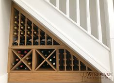 This compact under stairs area is now home to over 50 bottles of wine and champagne thanks to the bespoke solid oak wine racking. Oak Wine Rack, Wine Rack Wall, Wine Wall, Under Stairs Wine Cellar, Bar Under Stairs, Wine Rack Inspiration, Unique Wine Racks, Wine Rack Storage, Hidden Storage
