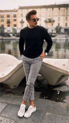 b9c5443ea51c48 Monochrome fall outfit with a black sweater sunglasses gray plaid pants  black leather banded watch no show socks white sneakers.
