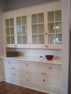 I would love a built in butler's pantry taking up the whole wall! think of what you could hide within!!! could also do drawers instead of cabinets below by Olive Oyl