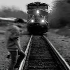 I heard a train calling, Through the middle of the night. I heard the whistle And the mercy of the wheels. It's a hand to mouth existence, In a mouth to nothing world. I was longing For the way I used to feel.