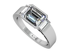 Kaitlyn is our Platinum East West Emerald Cut Diamond Engagement Ring with Baguettes