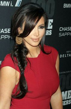 Kim looks gorgeous with simple #hairbraid. How many repins for her hairdo?