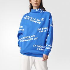 """The writing is on your sweatshirt in this edgy, whimsical graffiti-inspired design for women. Sporty and sassy, the relaxed French terry shirt features an allover print of """"The brand with the 3-Stripes"""" in German, French and English. Hidden zip pockets add to the urban vibe."""