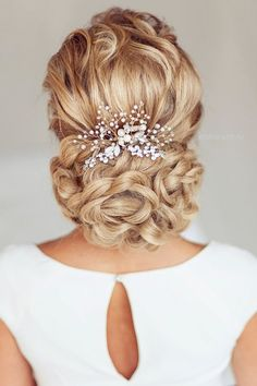 Gorgeous updo wedding hairstyle idea; Featured: Elstile