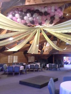 DIY ceiling drape and baloon drop.  You can pull it off with lots of help and someone who isn't afraid of tall ladders