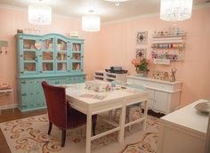 Super pretty craft room! LOVE that turquoise hutch!