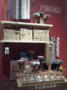 FORAGE tie display NYIGF August 2012...Beautiful ties and simple but striking display - long ties hanging and folded in individual open boxes, bow ties tied on stands, backstock in boxes labeled with color samples, bold logo on front of table and high on wall...love this tie company