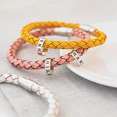 Personalized Leather Hoops Bracelet - would love this with the family names