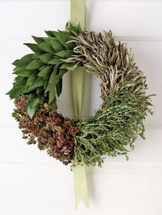 An edible Christmas wreath is not just for food fans it looks fantastic.  This one combines sage, oregano, rosemary, and bay leaves, all herbs associated with the Christmas feast.  kitchen window!