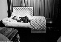 USA. Fairmount, Indiana. 1955. James Dean posing amusingly in a casket in a funeral parlor, seven months before he died