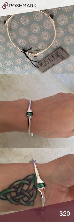 Robert Lee Morris Soho Sterling Silver Bangle Robert Lee Morris Soho Sterling Silver Mother-of-pearl Bangle Brand NWT ~~Please RESPECT my Items are already being sold at lowest possible prices (to include PM fees)!!. Low Ball Offers will be Ignored….Thank you for shopping my closet! Robert Lee Morris Jewelry Bracelets